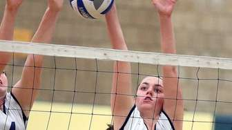 Massapequa's Mackenzie Byrne goes for the block during