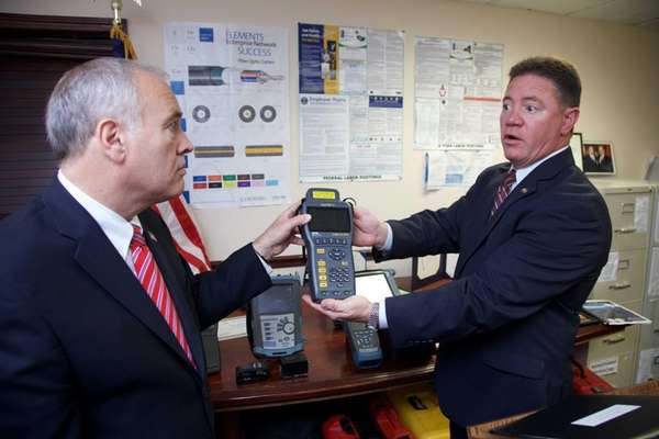 New York State Comptroller Thomas P. DiNapoli, left,