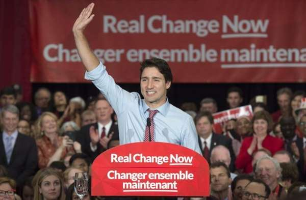 Prime Minister-designate Justin Trudeau waves to supporters as