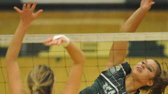 Seaford's Sophie Dandola, right, attempts to spike during