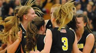 Wantagh teammates celebrate after their 3-0 win over