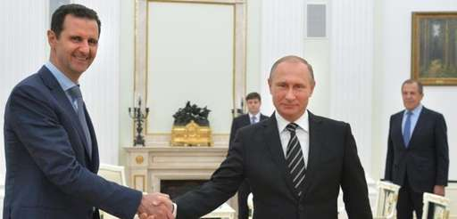 Russian President Vladimir Putin shakes hand with Syrian