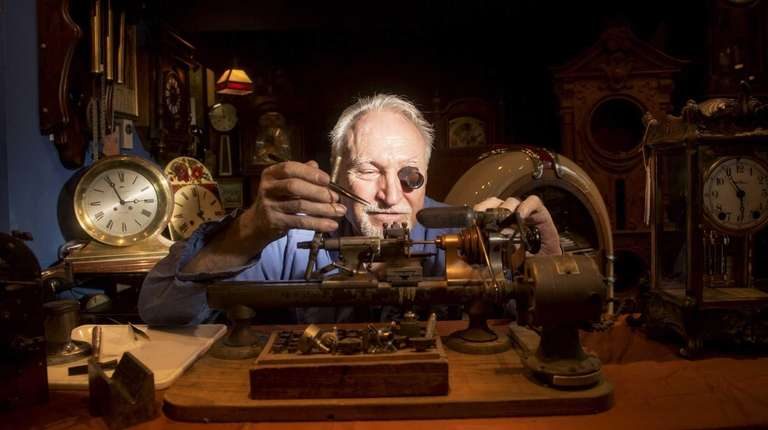 Jacques Chalikian, a fourth-generation clock restorer, wears a
