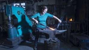 Blacksmith Rachel Miller at work at her shop,
