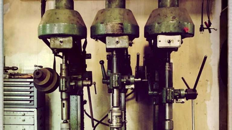 Three 1920s gang drill presses, still in use,