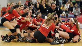 Connetquot celebrates their victory over Ward Melville in