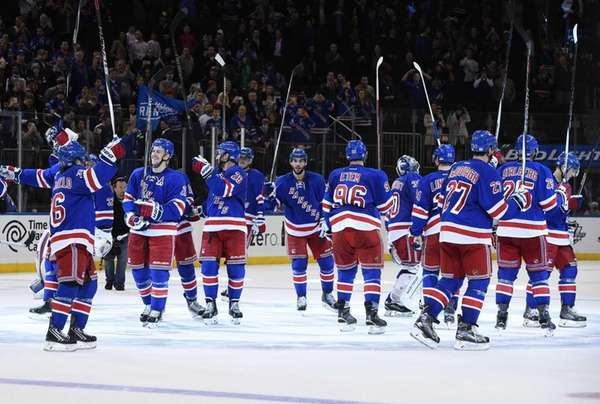 The New York Rangers salute the fans after
