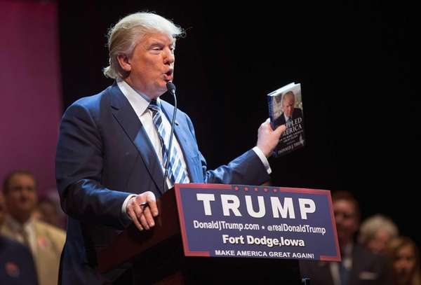 Republican presidential candidate Donald Trump talks about his