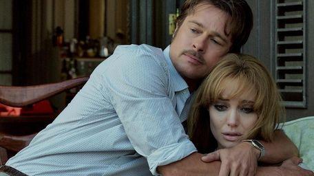 Roland (Brad Pitt) comforts Vanessa (Angelina Jolie Pitt)