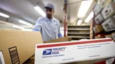 Packages wait to be sorted in a Post