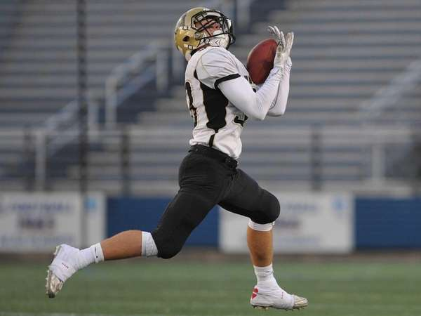 Wantagh's Jimmy Joyce fields a punt during a