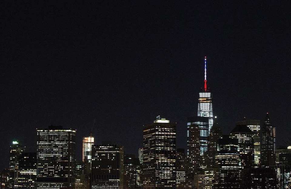 One World Trade Center's spire is shown lit
