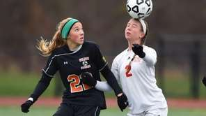 Center Moriches' Janine Ratti (2) heads the ball