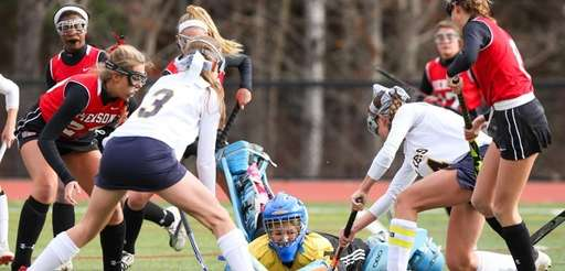Pierson/Bridgehampton's Charlotte Johnson (89/center) makes the save during