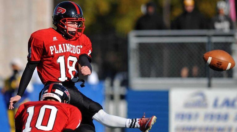Plainedge kicker No. 18 Dylan Burns splits the