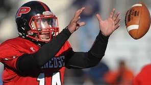 Plainedge quarterback No. 14 Davien Kuinlan takes a