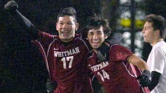 Whitman's Witman Hernanadez, left, and Anthony Palazzolo celebrate