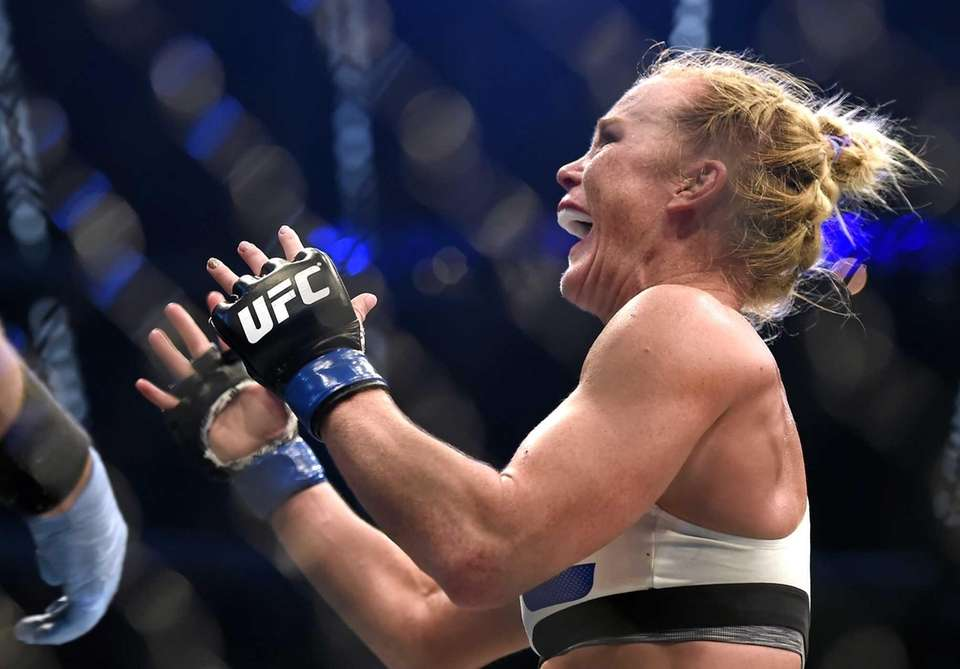 Holly Holm celebrates after defeating Ronda Rousey during