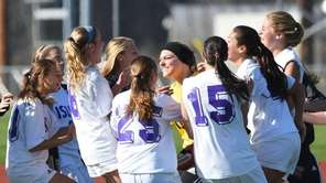 Islip's players celebrate following their victory over Jamesville-DeWitt
