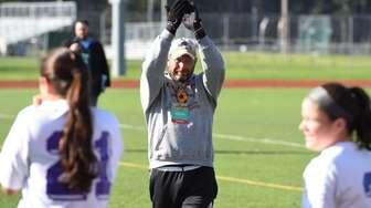 Islip head coach Mike Reilly gestures to the