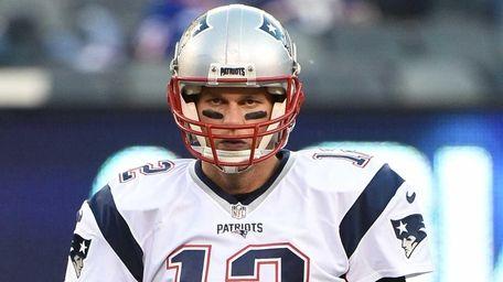 New England Patriots quarterback Tom Brady warms up