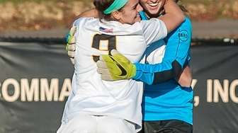 St. Anthony's Sabrina Cristodero, left, gives goalie Camryn