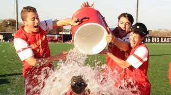 Chaminade head coach Michael Gallagher is doused with
