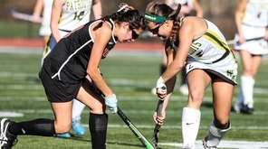 Ward Melville's Lexi Reinhardt (9) battles the ball