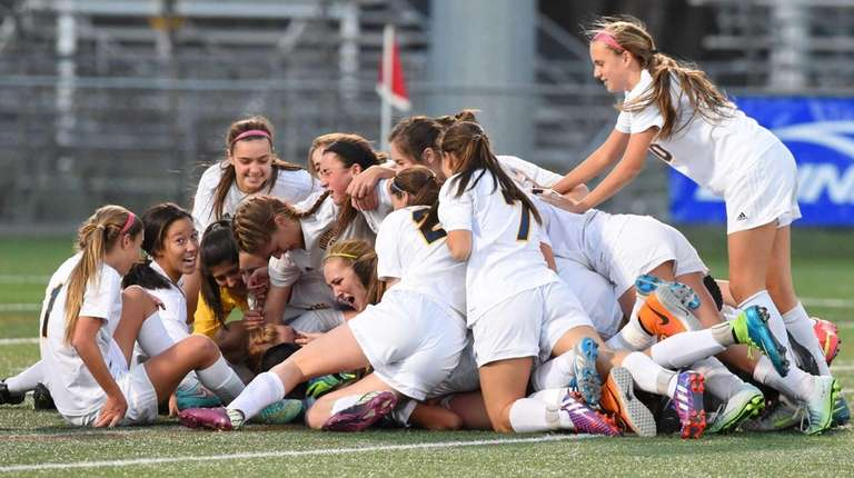 Massapequa players celebrate their victory over Baldwinsville after
