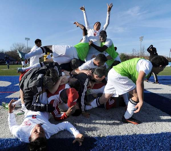 Amityville players celebrate their championship win after the