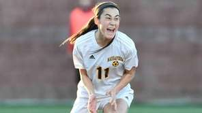 Massapequa's Hope Breslin (11) reacts to her goal