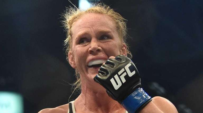 Holly Holm of the US celebrates after winning