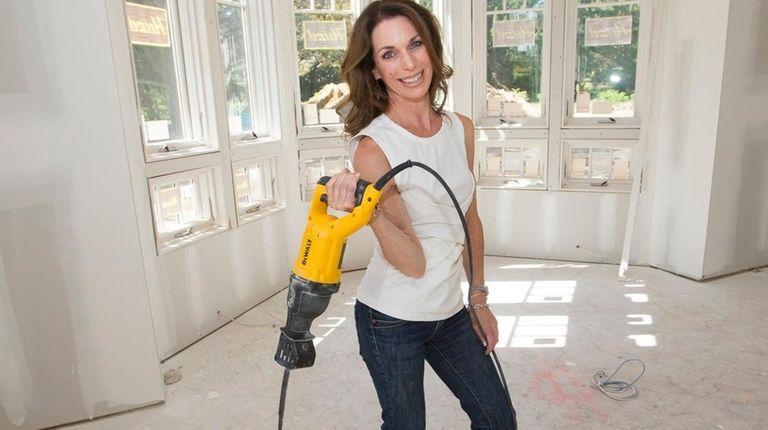 Interior designer Kate Singer poses in a home