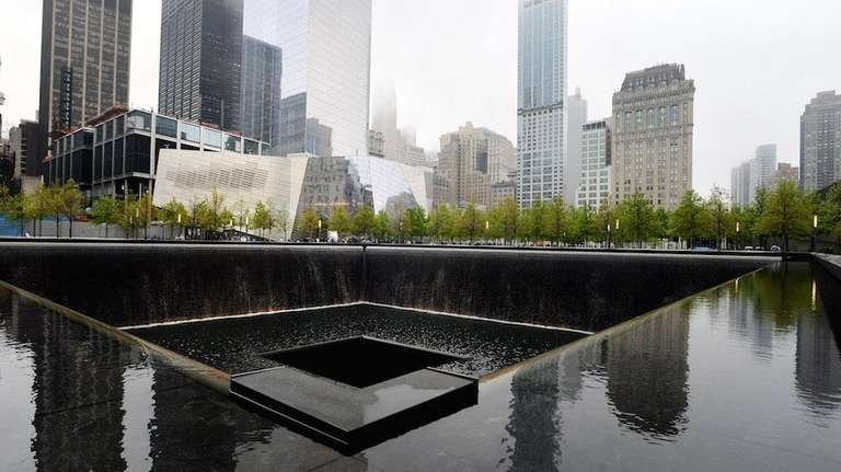The National September 11 Memorial Museum stands beyond