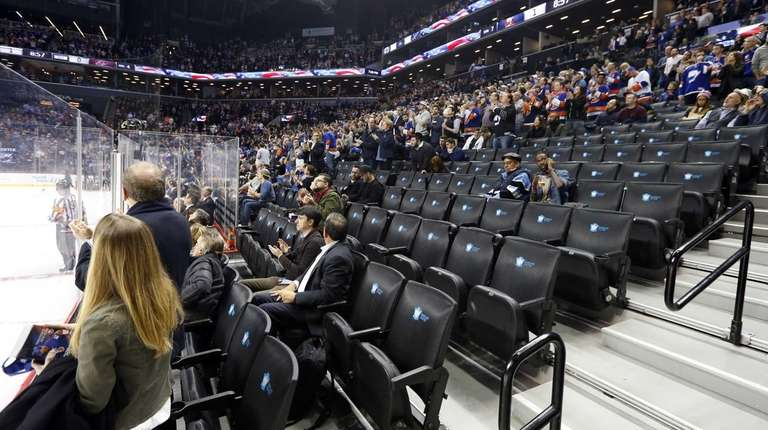 Empty seats are seen during the game between