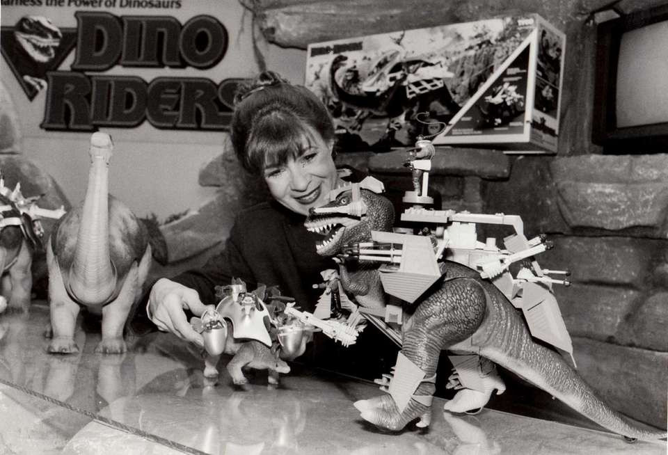 Joyce Lyons demonstrates TYCO's DinoRider dinosaur replicas at