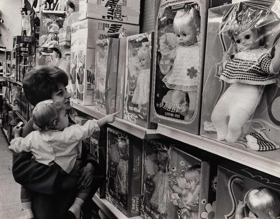 Angela Nudo of Westbury looks at dolls for
