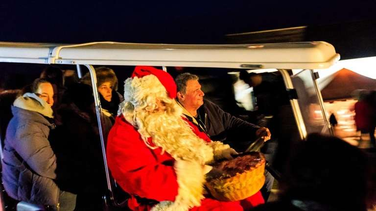 Santa Claus entertains the crowds at the annual