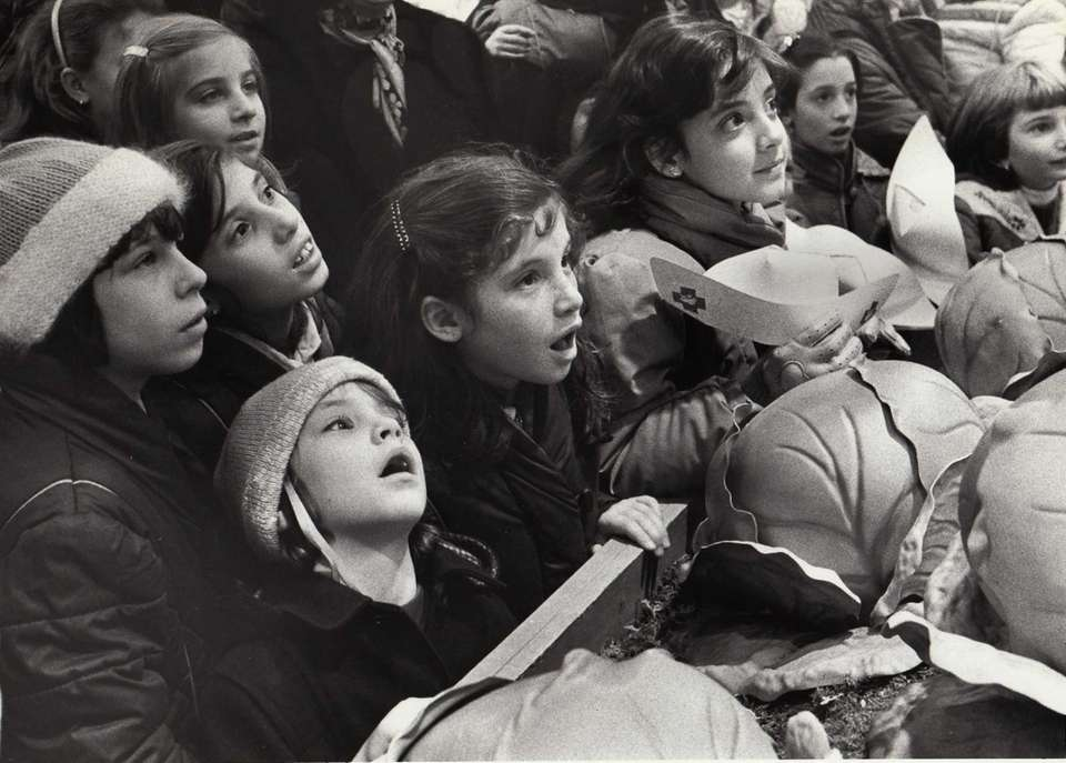 Children watch as a Cabbage Patch Doll is