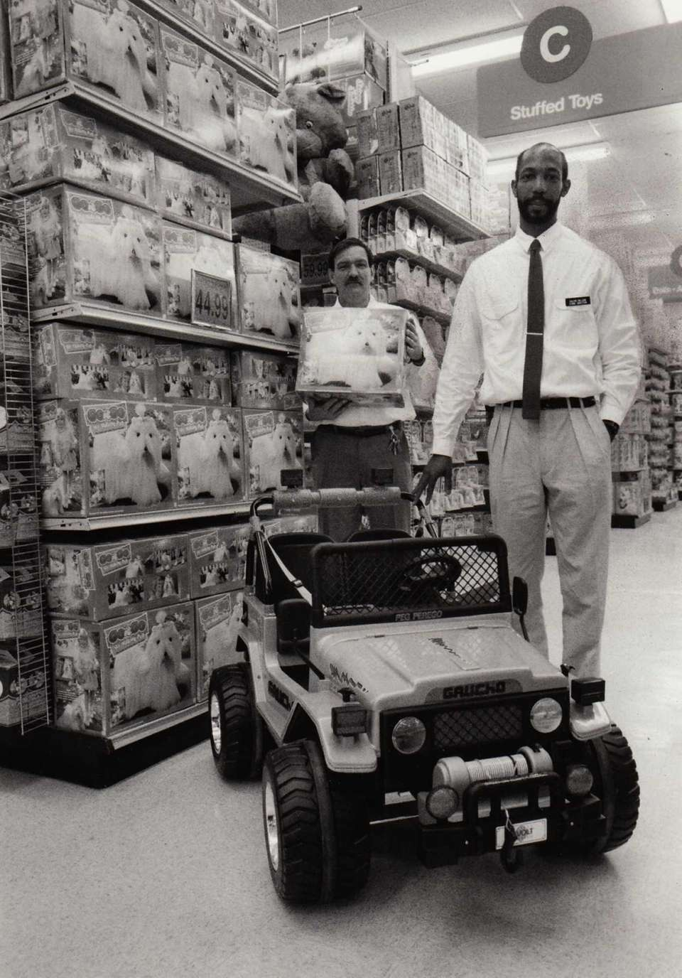 Store managers Mike Mallon, left, and Calvin Nelson,