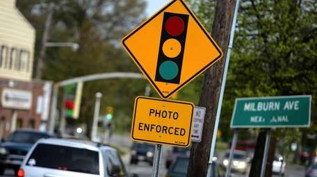 A sign indicating the presence of a red-light