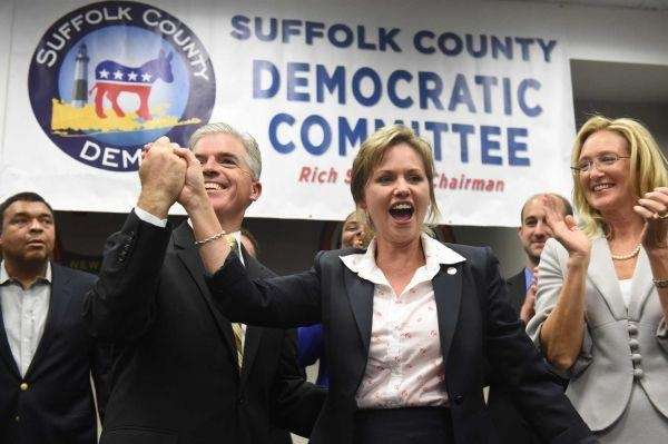 Suffolk Legis. Sarah Anker (D-Mount Sinai) celebrates on