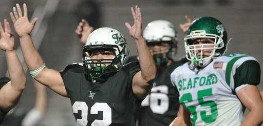 Locust Valley No. 22 Tom Talenti, left, reacts