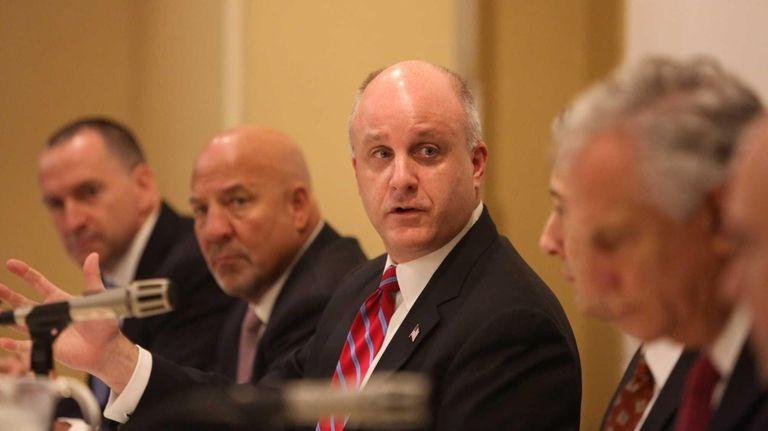 Nassau Interim Finance Authority Director Christopher Wright speaks