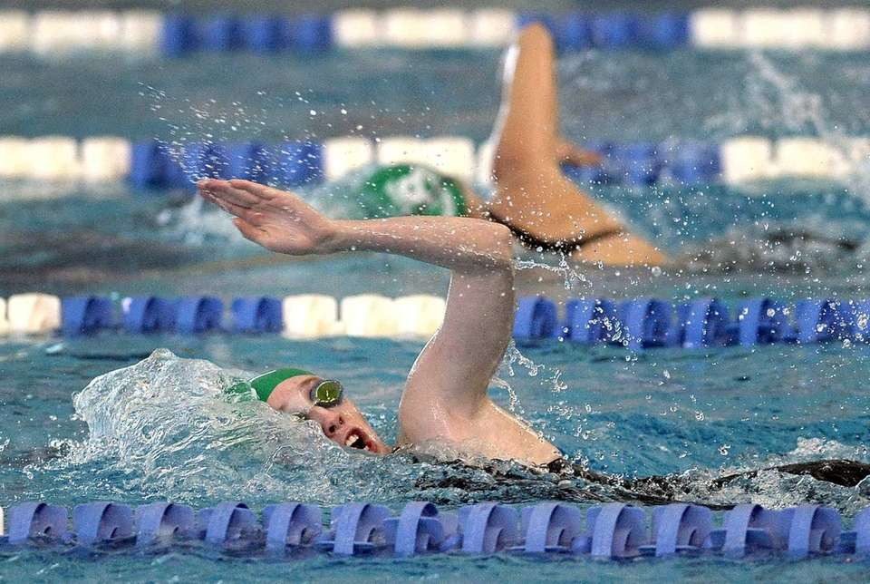 Port Washington's Annabelle Corcoran swims in a preliminary