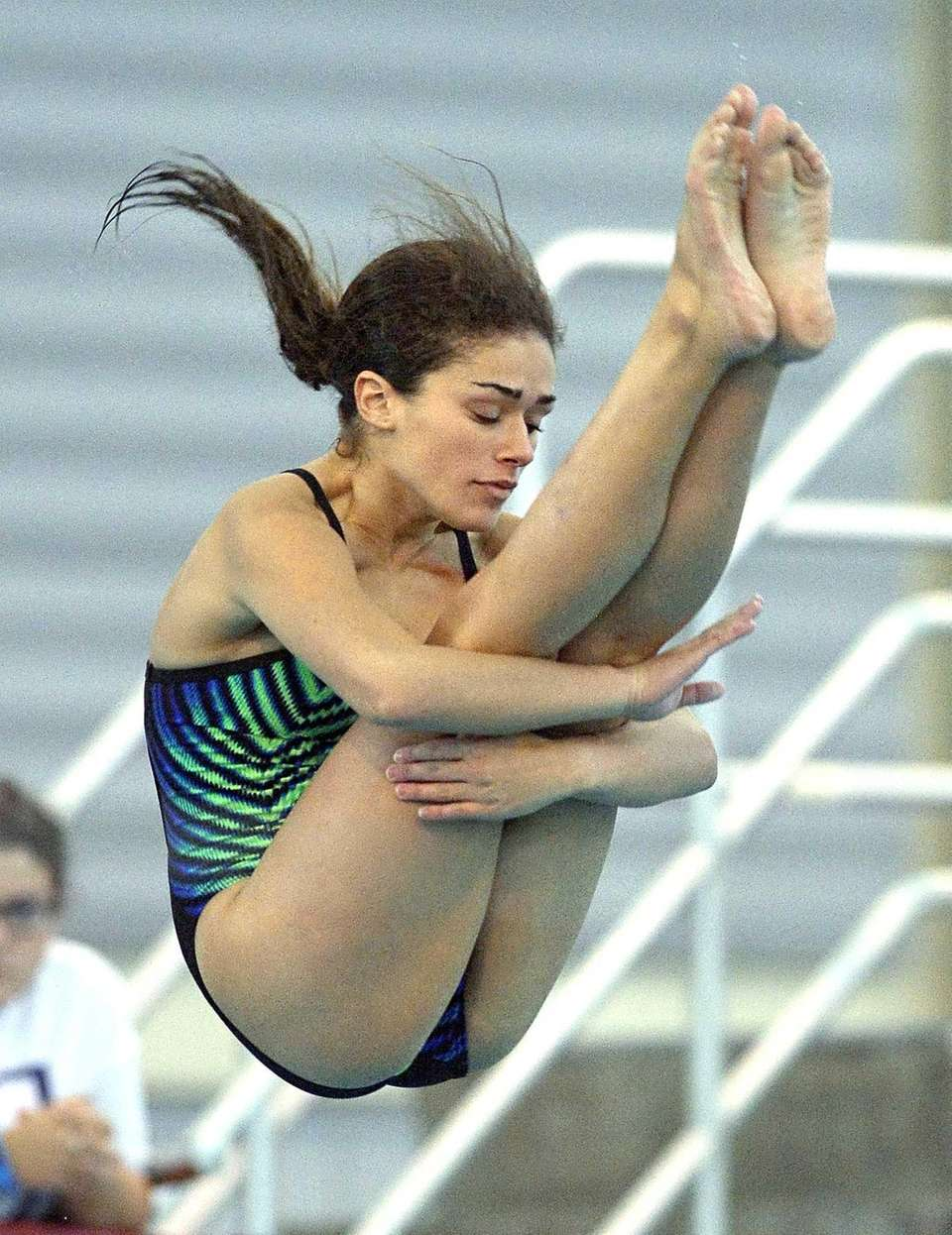 Lindenhurst's Gianna Cornelia performs a dive during the