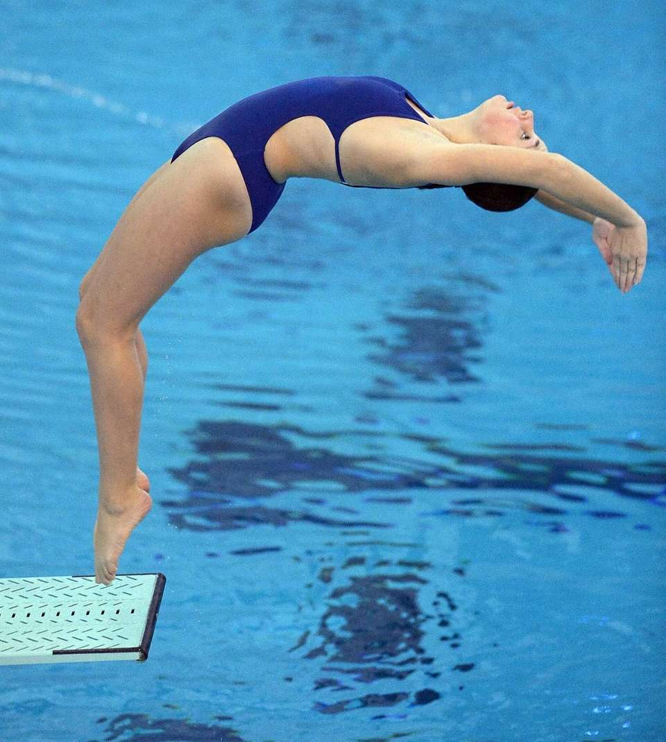 Huntington's Patricia Arceri performs a dive during the