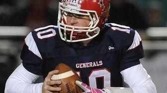 MacArthur quarterback Jimmy Kelleher (10) looks for an