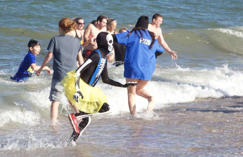 People participate in a polar plunge sponsored by