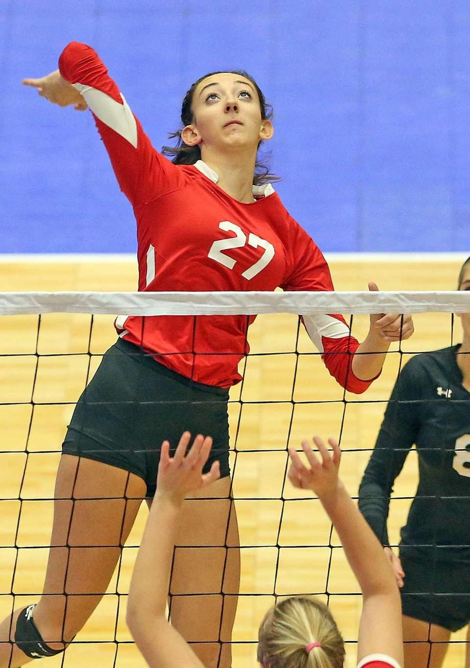 Connetquot's Cassandra Patsos sets for the overhead during